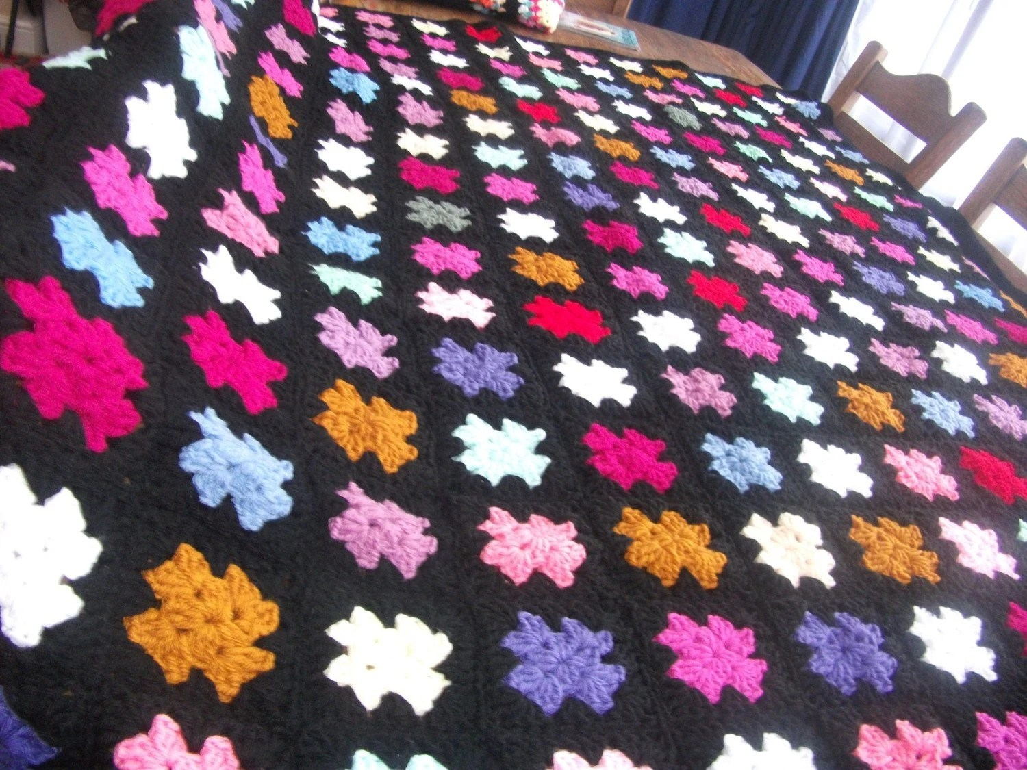 Handmade chunky crochet blanket -  Made in tradition granny type multi colour style with black border   2