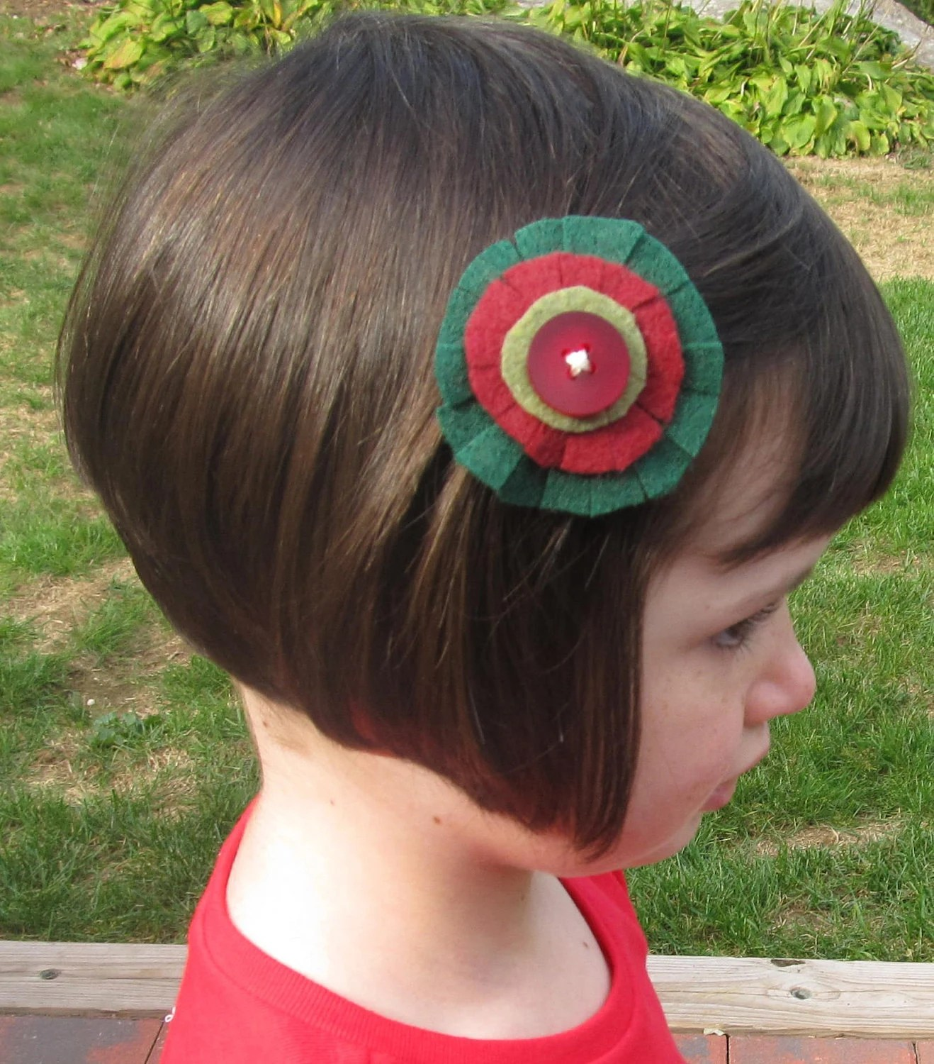 Girl's felt Christmas snap clip, green and red with button accent