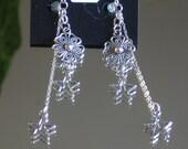 Sterling Silver Earrings. Sterling Silver Chain. 925 Stamped Sterling Silver Ear wires. Tibetan Silver Charms. 2 inch earrings