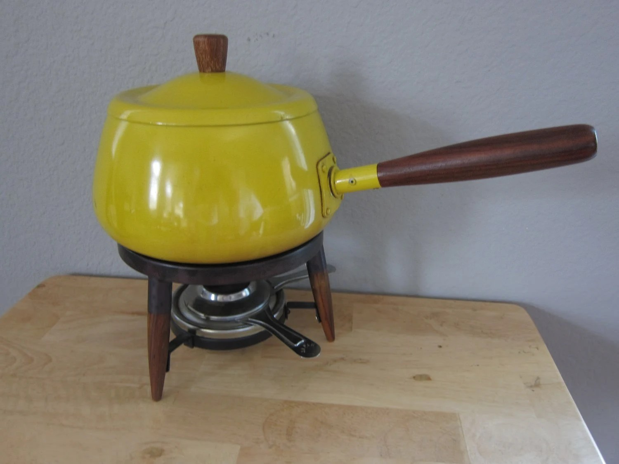 Mid Century yellow fondue set with teak legs