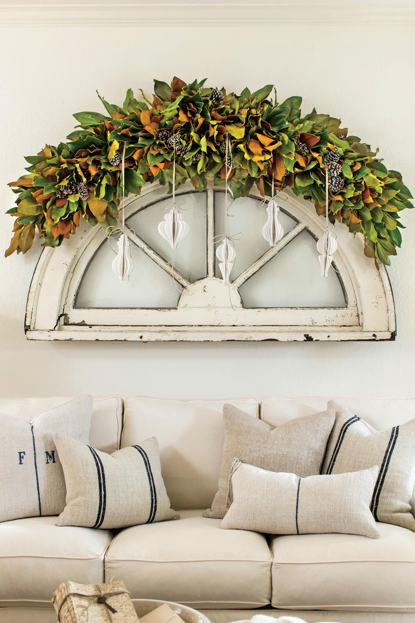 10 Ways to Decorate with Magnolia this Christmas   Southern Living Magnolia with Ribbon Hanging