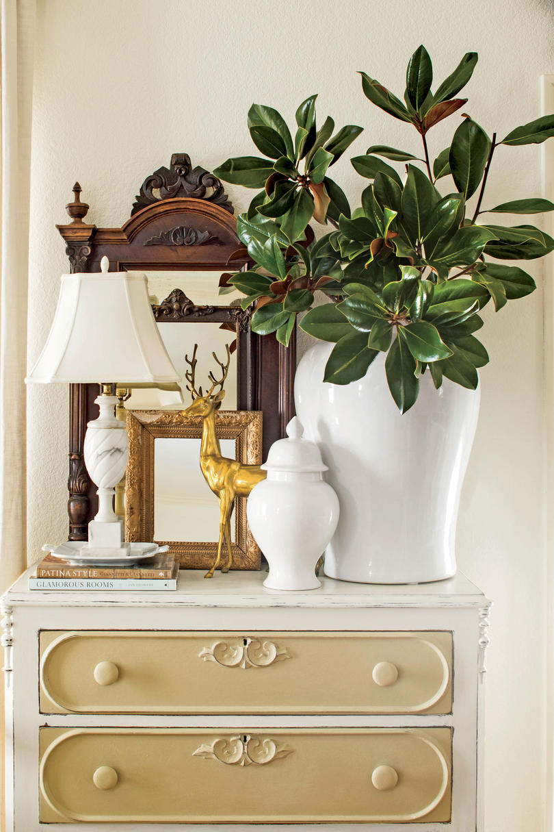 10 Ways to Decorate with Magnolia this Christmas   Southern Living Magnolia with White Jars