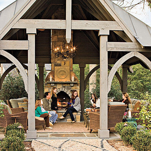 Glowing Outdoor Fireplace Ideas - Southern Living on Southern Pools And Outdoor Living id=32987