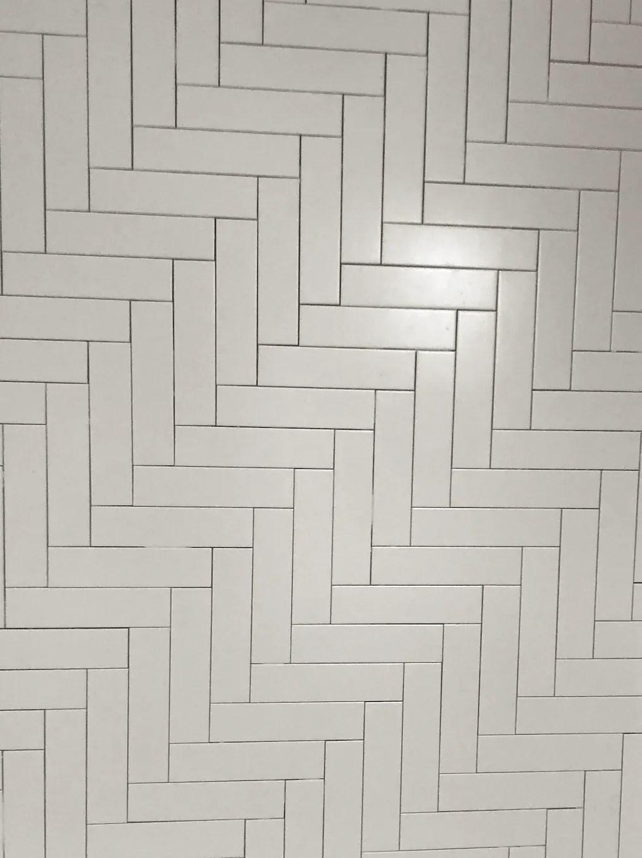 4 x 12 ceramic subway tile laid in