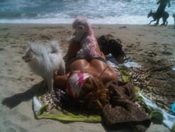 Aubrey O'Day laying down in a bikini at a beach - Hot Celebs Home