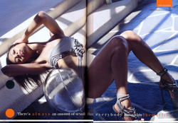 Zoe Saldana in black swimsuit showing legs and pokies in British GQ magazine August 2010 - Hot Celebs Home