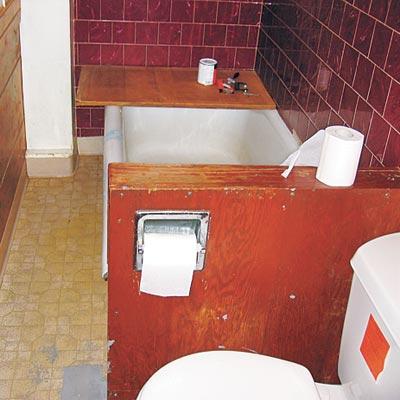 bathroom with vinyl flooring, white soaking tub and sink