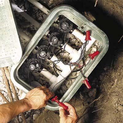 Installing the zone valves when installing an in-ground sprinkler