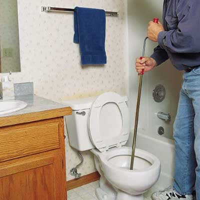 repairing a clogged toilet