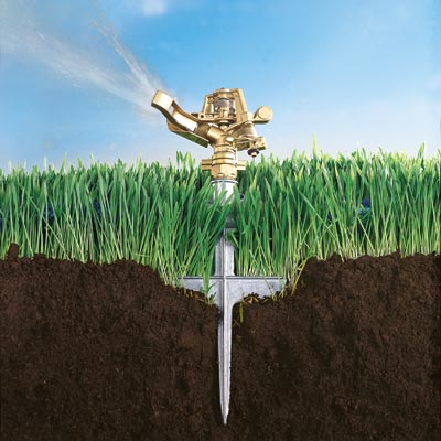 pulsating sprinkler planted in grass and soil