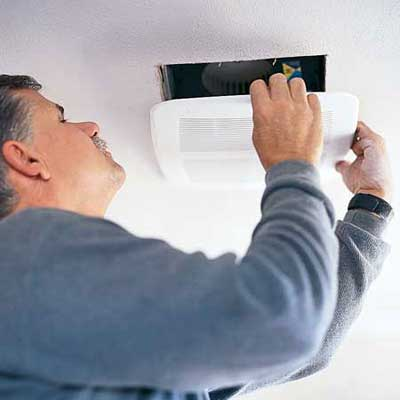 person installing an indoor air vent