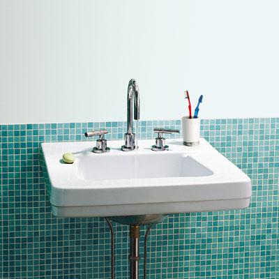 bathroom sink with blue tile