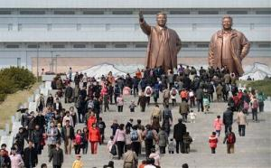 People visit giant statues of the late North Korean leaders, Kim Il Sung, left, and his son Kim Jong Il, in Pyongyang, North Korea, Monday, April 15, 2013.