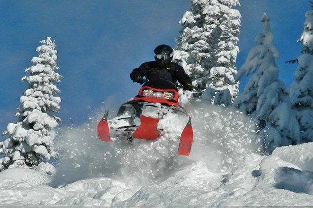 Snowmobiling is a popular guest activity at Seven Devils