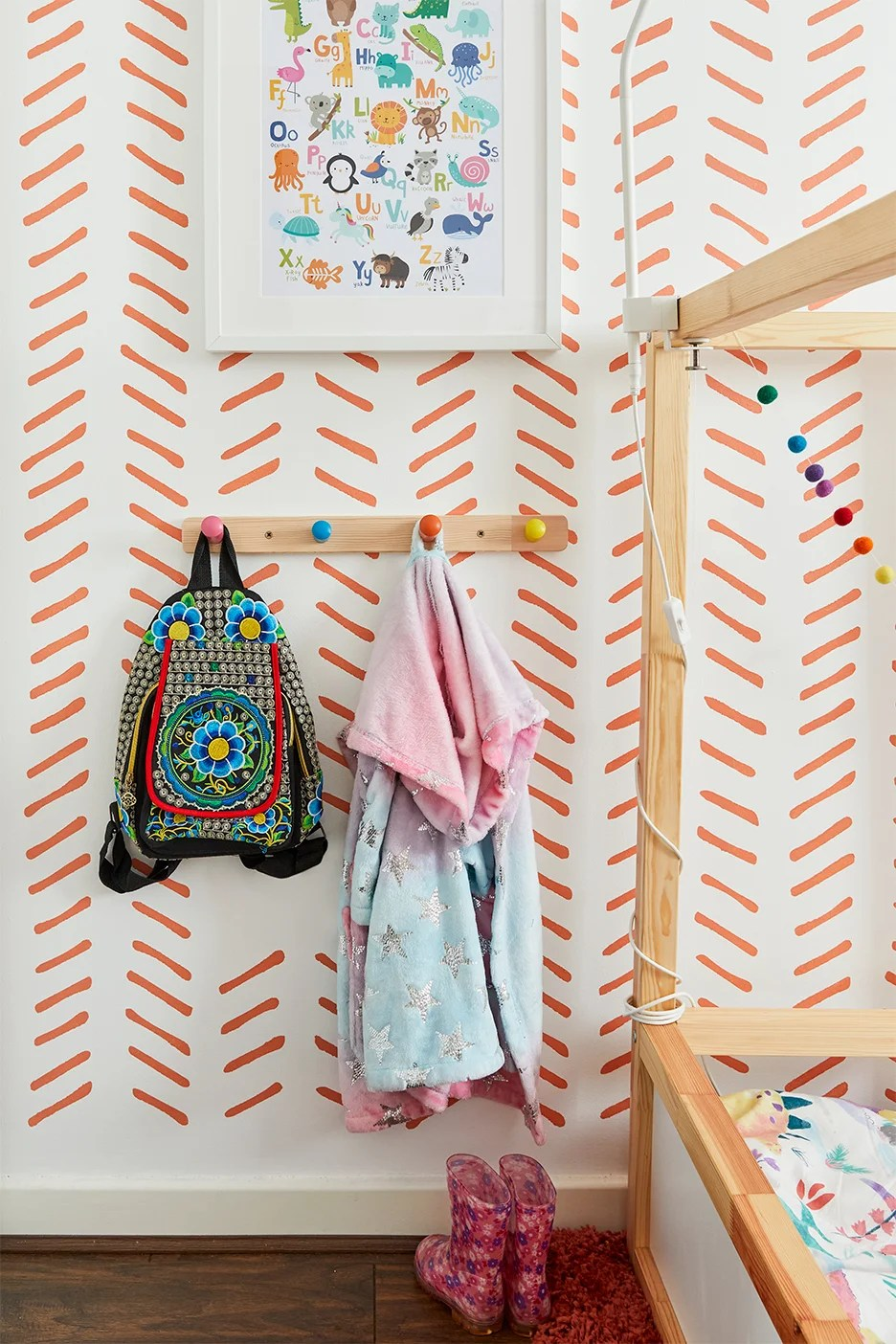 kids backpack hanging on wall