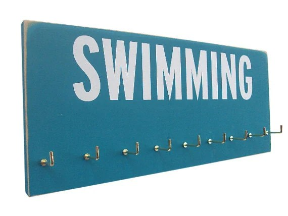 Swimming: Use a Medals Rack to display your swimming ribbons - runningonthewall