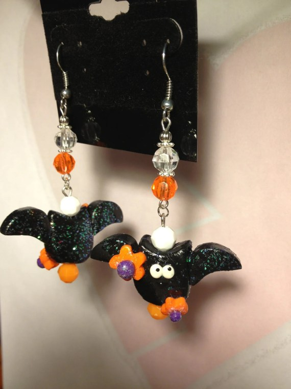 Adorable Halloween earring...cute bat with orange flowers...hypoallergic hooks - HeartbreakBoutique