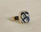 Stamped, ceramic, blue, adjustable ring.