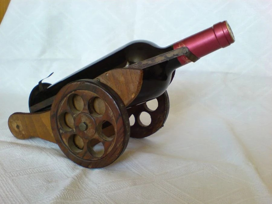 Antique Wooden wine bottle holder/frame Gun