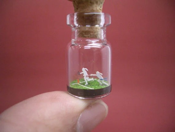 Flag Football players in a tiny bottle