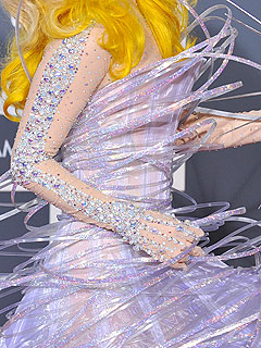 Detail of her Armani Privé dress