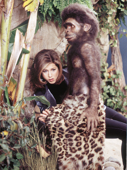 We just really like this picture of Aniston with a caveman diorama in a museum.