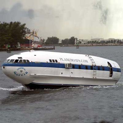 cosmic muffin plane-house-boat, howard hughes plane repurposed into a boat