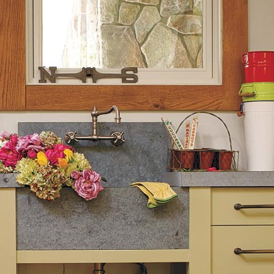 open to the outdoors potting room with rustic sink and counter
