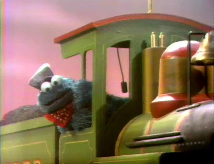 Cookie Monster as Casey Jones driving a train