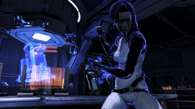 Miranda Lawson, CGI white human female, very pretty, wielding biotic powers in a pose that coincidentally draws attention to her vulva. Hey, at least she's fully dressed!
