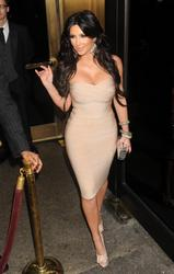 Kim Kardashian cleavagy wearing body-hugging dress at Carmelo Anthony's wedding in New York City - Hot Celebs Home