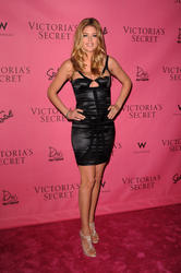 Doutzen Kroes cleavagy and leggy in small black dress at Victoria's Secret Supermodels Celebrate the Reveal of the 2010