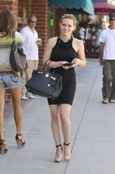 Hilary Duff in small sexy black dress shopping at Gucci in Beverly Hills - Hot Celebs Home