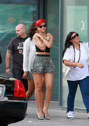 Rihanna leggy in mini skirt and cleavagy (great downblouse shoot!) as she leaves her hotel in Ontario - Hot Celebs Home