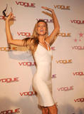 Gisele Bundchen wearing white body hugging dress showing her curves launches Vogue Eyewear Play Everyday Campaign in Ibiza in Spain