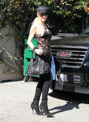 Paris Hilton sexy in sheeer black top showign black bra as she does some shopping at Kate Somerville in Los Angeles - Hot Celebs Home