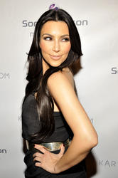 Kim Kardashian poses for a picture at the relaunch of her website held at The Tea Room at H.Wood Nightclub on June 25, 2010 in Hollywood, California - Hot Celebs Home
