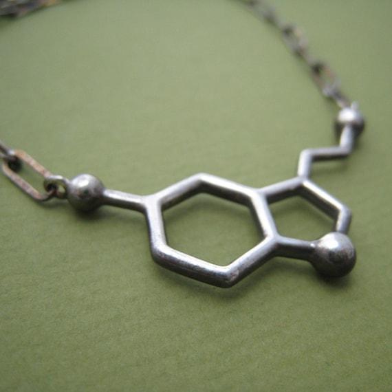 serotonin molecule necklace, styled for men