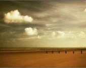 On Dymchurch Beach - golden autumnal reds and coppers with bright white clouds - matthewbull