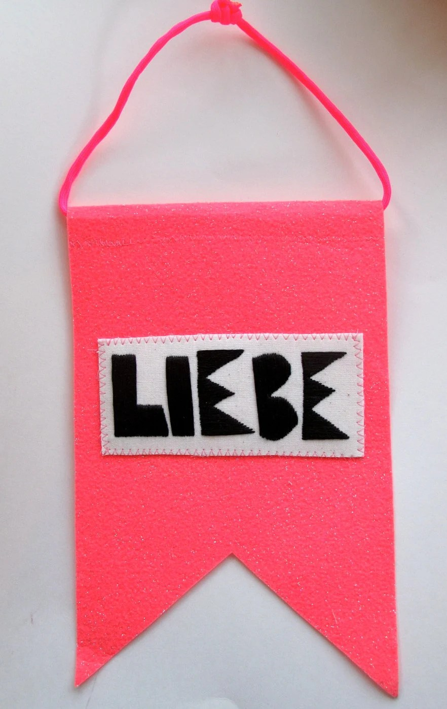 Love banner Valentine's Day with German word for love Liebe in black and hot pink wall hanging home decor