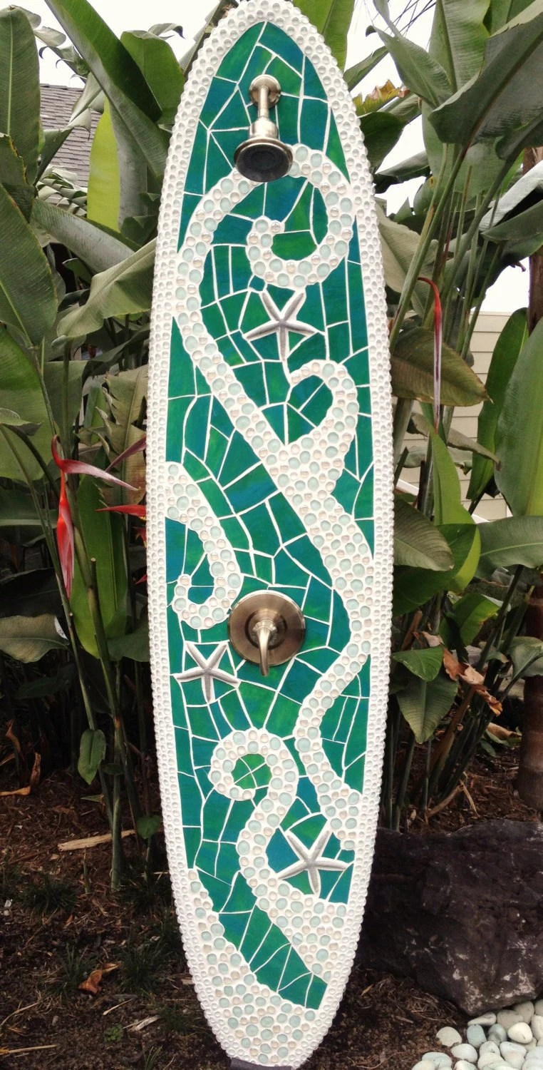 Longboard outdoor surfboard shower with glass and starfish design. Ready for use
