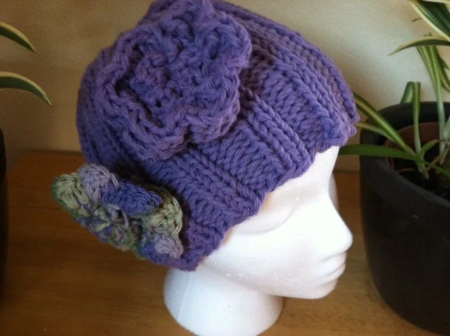Purple knitted beanie hat with cute detachable flowers