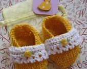 Gorgeous sunshine yellow and ivory lace knitted baby booties with matching gift bag and card