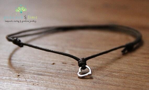 heart wish bracelet on dark brown