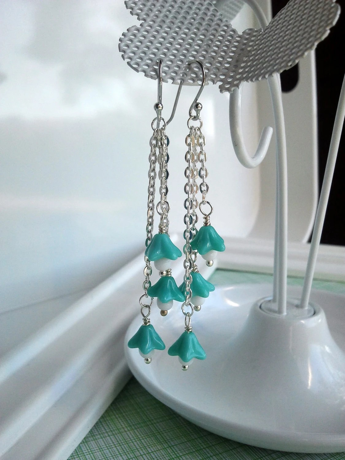 "Czech glass ""Waterfall of Bells"" earrings with matte silver chain (turquoise/teal)"
