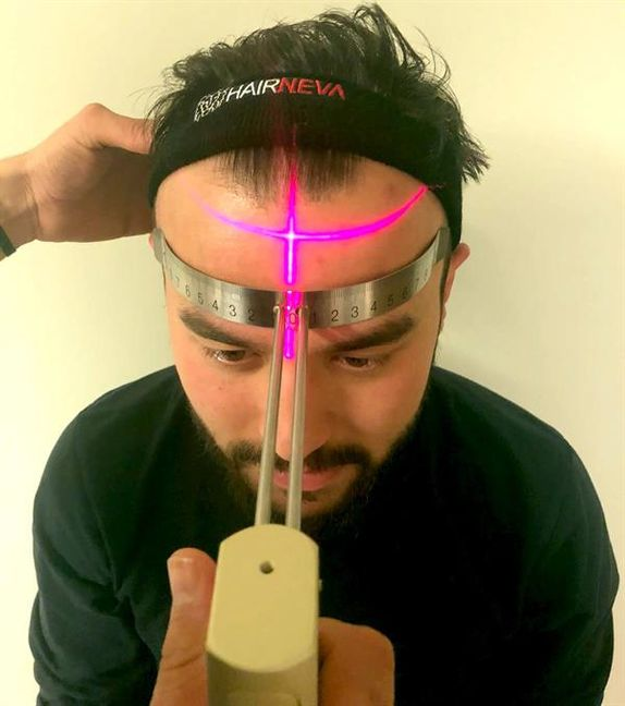 Laser therapy, a form of light and heat therapy to stimulate hair growth and treat genetic alopecia in men and women.