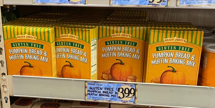 An image of boxes of pumpkin muffin mix on a shelf.