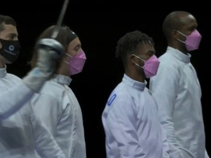 US fencing team wears pink mask to protest against teammate accused of sexual assault.