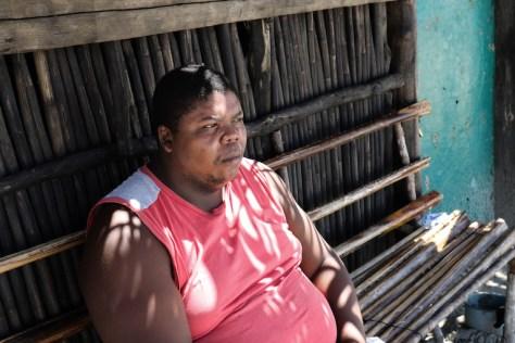 Cesar Benedict looks out to sea in Triunfo de la Cruz. Image by Christopher Clark for Mongabay.