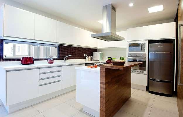 As cozinhas passaram a seguir o modelo americano, com bancadas em ilhas ou penínsulas e normalmente abertas para a sala, criando um extenso loft  (Arquivo Pessoal/Divulgação)